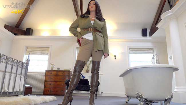 Tight jodhpurs Magic Wand with leather thigh boots riding her Hitachi Magic Wand.