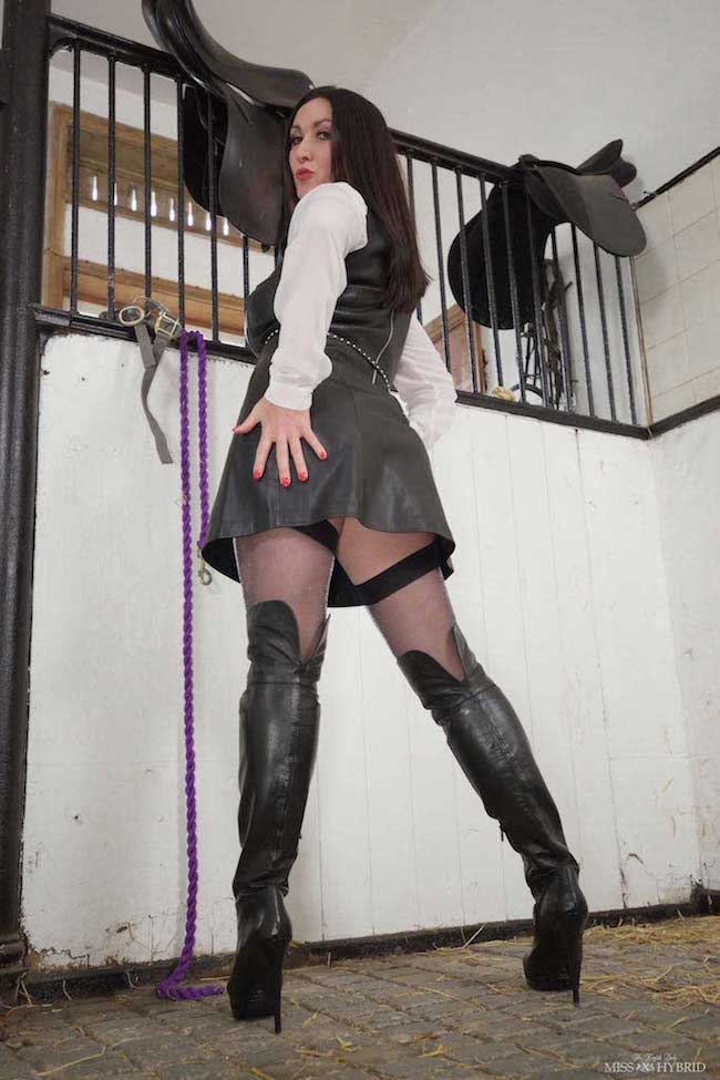 Leather boots riding mistress Miss Hybrid loves the feel of leather on her skin.